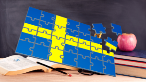 Swedish flag puzzle pieces in front of a classroom