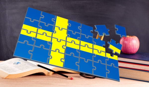 Swedish flag puzzle with a school chalkboard and desk behind it